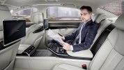 Новая Audi A8: «подпрыгивающая» подвеска, смартфон вместо ключа и массаж ступней - фото 24