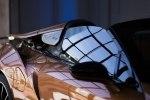 BMW официально представила открытую модификацию гибридного споткара i8 - фото 18
