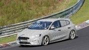 Заряженный Ford Focus четвертого поколения засекли на тестах - фото 4