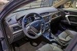 Geely привезла в Москву гибридный седан с начинкой Volvo - фото 11