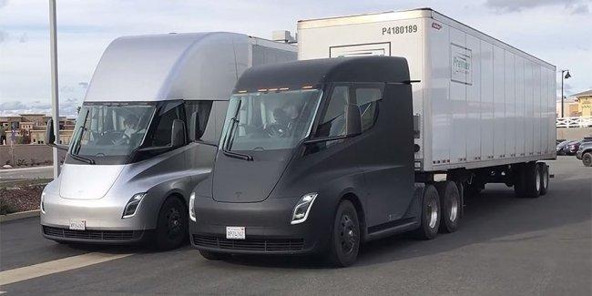 Пару тягачей Tesla сняли на видео с настоящими прицепами