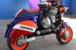 Заряженный скутер Vespa Repsol CBR